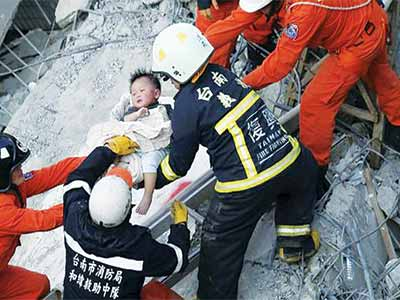 A six-month-old baby girl was pulled alive from the ruins of an apartment building in Taiwan 30 hours after it was brought down by an earthquake on Saturday PHOTO: BBC
