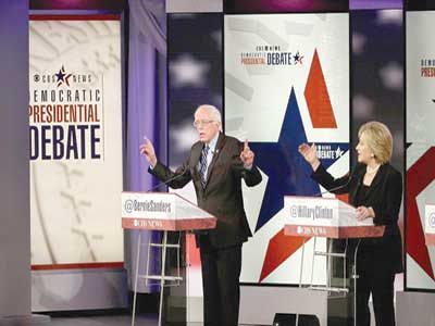 Bernie Sanders and Hillary Clinton pressing their points during a Democratic presidential primary debate in Des Moines, Iowa PHOTO: CHARLIE NEIBERGALL/AP