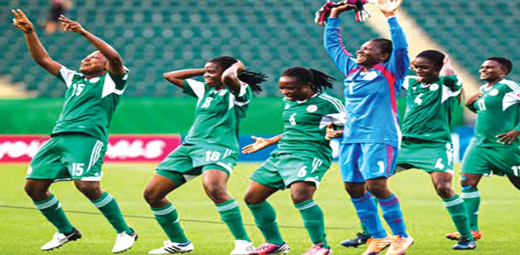 Super Falcons players celebrate victory at Namibia 2015 AWC