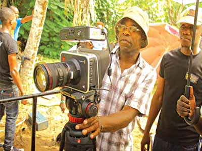 Director of Photography, Mr. Tunji Akinsehinwa and Director, C.J. 'Fiery' Obasi on set of O-Town