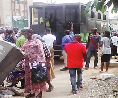 Offenders being taken away in a Black Maria