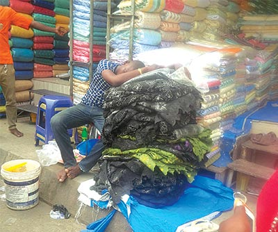 A trader sleeping on duty...no sales              PHOTO: TEMILOLUWA ADEOYE