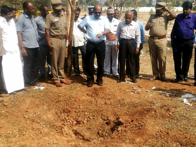 Indian authorities inspect the site of a suspected meteorite landing on February 7, 2016 in Vellore district in southern Tamil Nadu. PHOTO: AFP