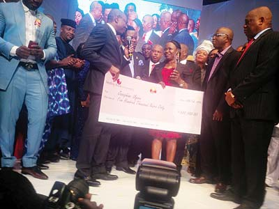 Chief Executive Officer, Sterling Bank Plc, Yemi Adeola (left); Obiano; recipient, Ms Josephine Ugwu an Dr. Orji Uzor Kalu, during the presentation of the cheque to Ugwu, in Lagos…at the weekend.