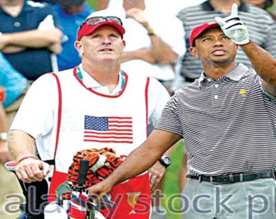 Tiger Woods (right) and his caddie Joe LaCava waiting to play during Foursome competition in the Presidents… Stock Photo