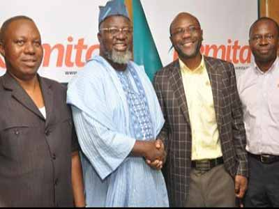 (L-r): Arch. Enoch Ogun, acting Postmaster General, Nigeria Postal Services, Adebayo Shittu, minister of Communication, John Obaro MD/CEO, Systemspecs, ... PHOTO: www.nigeriacommunicationsweek.com.ng