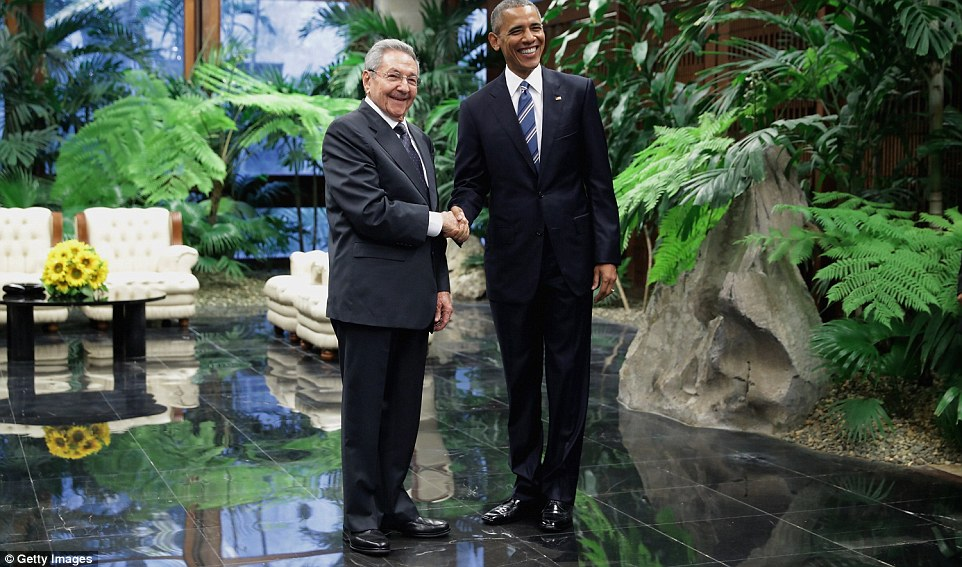 U.S. President Barack Obama, right, and Cuban President Raul Castro greet one another before a meeting at the Palace of the Revolution in Havana. (Chip Somodevilla/Getty Images)