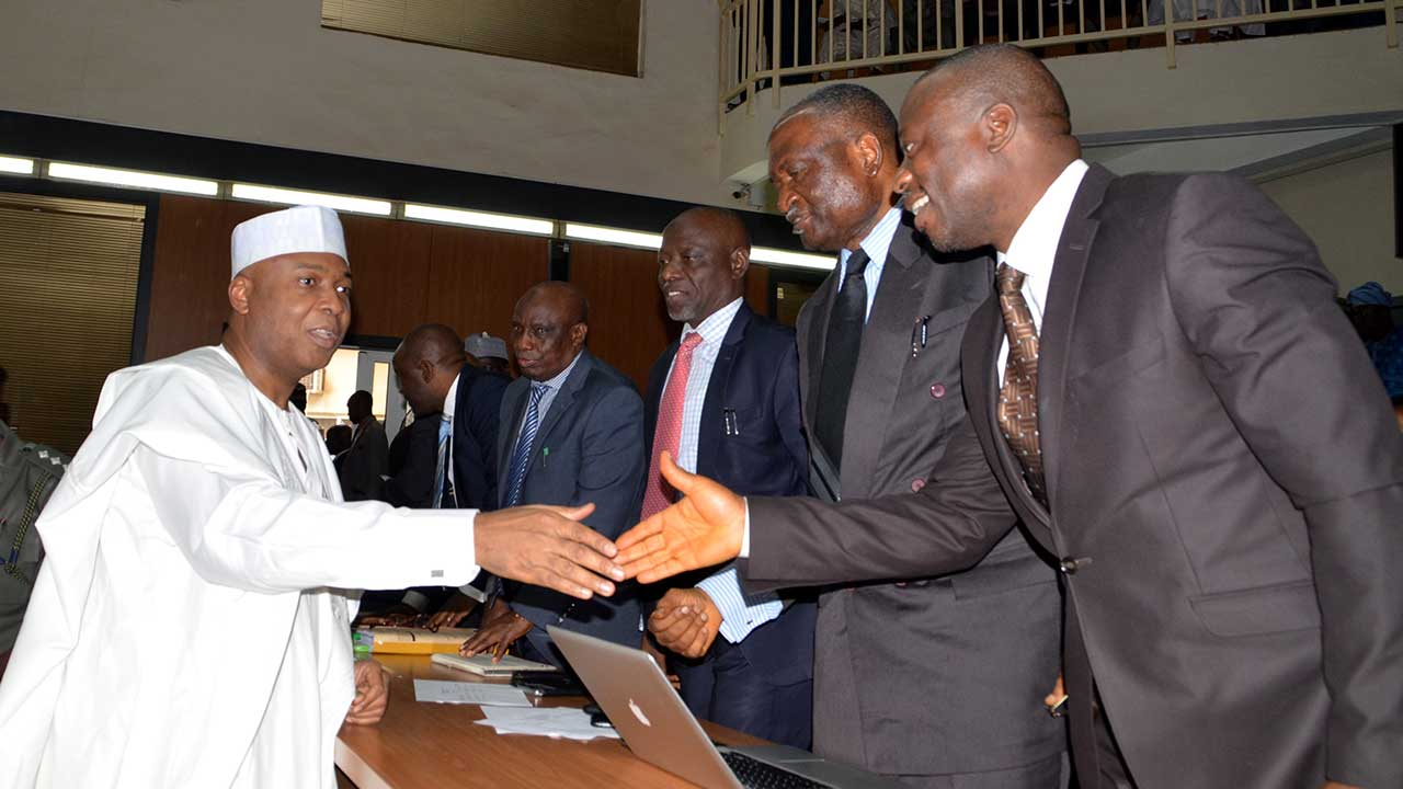 Senate President,Senator Bukola Saraki exchanging pleasantries with his lawyers during his appearance before the code of Coduct Tribunal in Abuja on 24/03/16. PHOTO: Ladidi Lucy Elukpo.