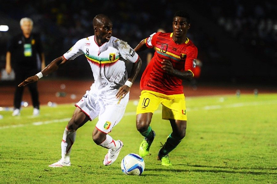 MONGOMO, EQUATORIAL GUINEA - JANUARY 28: Mustapha Yatabare (L) of Mali vies for the ball against Kevin Constant (R) of Guinea during the Africa Cup of Nations Group D soccer match between Guinea and Mali at Estadio de Mongomo in Mongomo, Equatorial Guinea on Wednesday, January 28, 2015. (Photo by Mohamed Hossam/Anadolu Agency/Getty Images)