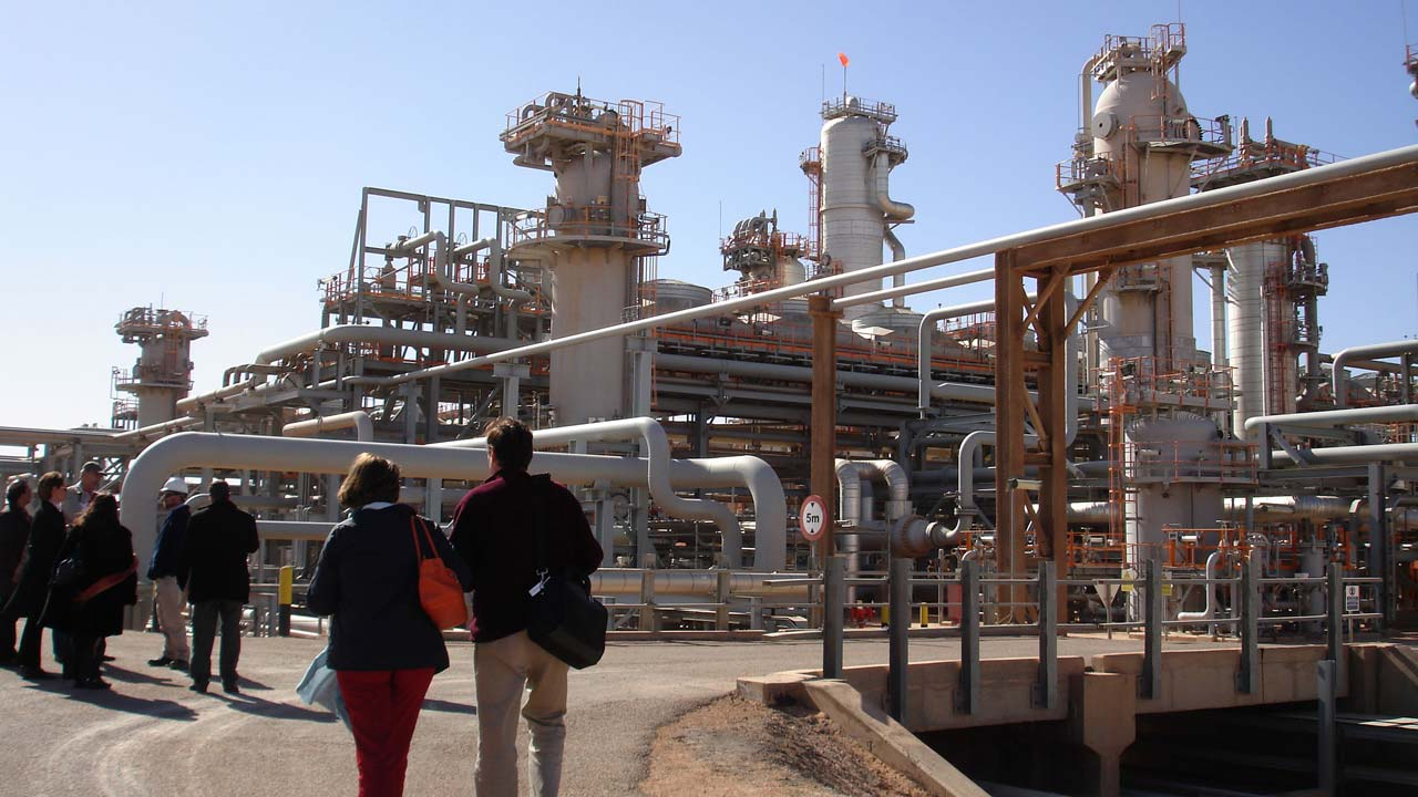 (FILES) This file photo taken on December 14, 2008 shows a foreign delegation visiting the Krechba gas treatment plant, about 1,200 km (746 miles) south of Algiers. Rockets on March 18, 2016, struck an Algerian gas plant run by foreign energy giants in an attack claimed by Al-Qaeda, three years after a deadly hostage crisis at another facility in the country. There were no casualties reported in the attack on the plant operated by Britain's BP, Norway's Statoil and Algerian company Sonatrach.STR / AFP