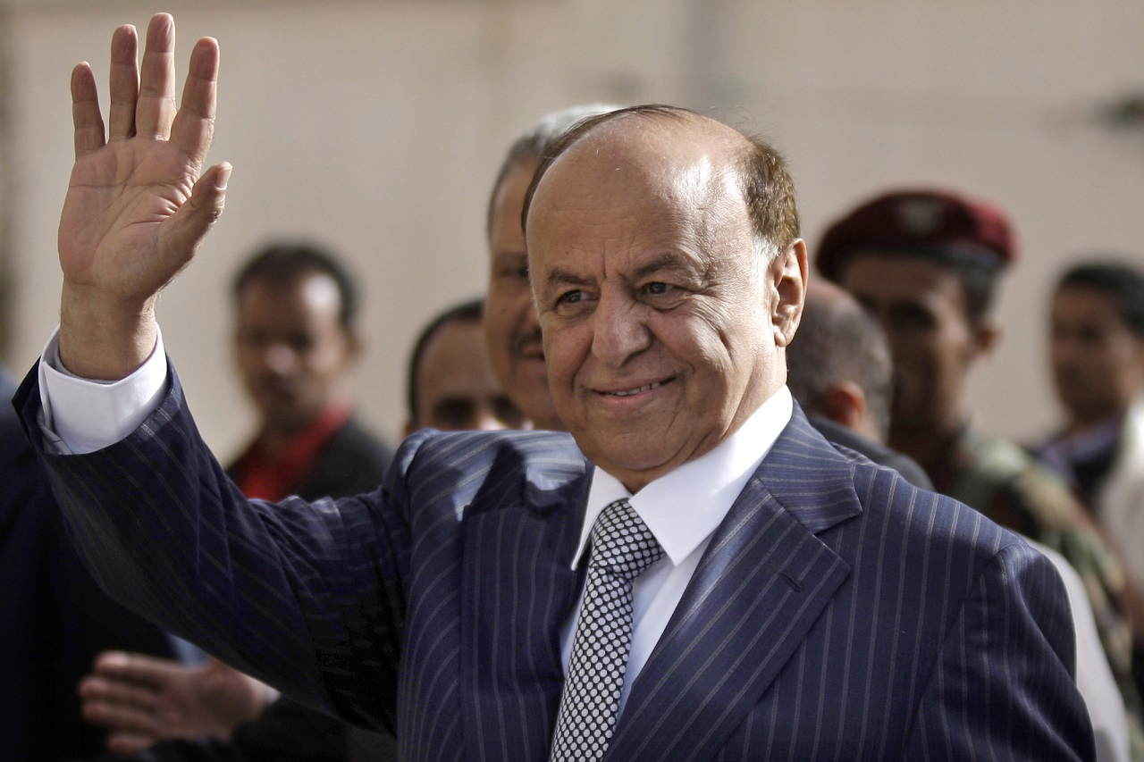 "FILE - In this Tuesday, Feb. 21, 2012 file photo,Yemen's then Vice President Abed Rabbo Mansour Hadi waves as he enters a polling center to cast his vote in Sanaa, Yemen. Yemen's Shiite rebels said Tuesday, Feb. 24, 2015 that President Abed Rabbo Mansour Hadi, who fled the rebel-controlled capital earlier this month and has begun reconstituting his authority in the south, is ""wanted for justice."" The move escalated a crisis that threatens to split the Arab world's poorest country. (AP Photo/Hani Mohammed, File)"