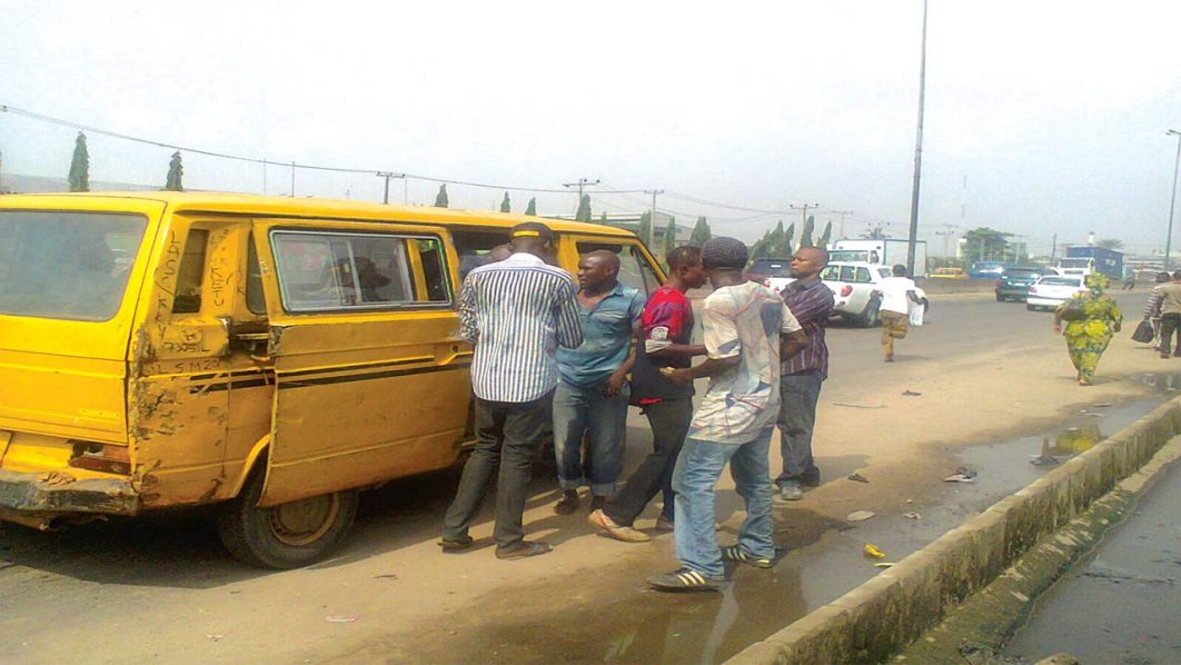 Touts at work in Oshodi, Lagos