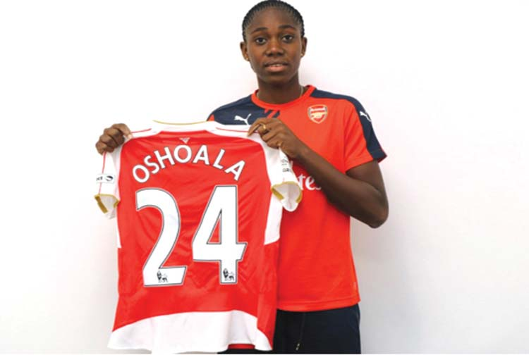 Asisat Oshoala displaying her Arsenal Ladies' jersey after completing her switch from Liverpool to the Gunners.