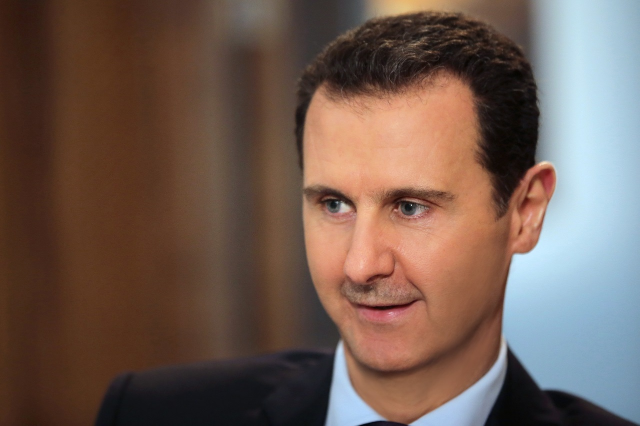 "(FILES) This file photo taken on February 11, 2016 shows Syrian President Bashar al-Assad listening to a question during an exclusive interview with AFP in the capital Damascus. Syrian President Bashar al-Assad pledged on MArch 1, 2016 to do his part to ensure a fragile ceasefire holds and offered ""full amnesty"" to rebels who hand in their weapons. / AFP / JOSEPH EID"