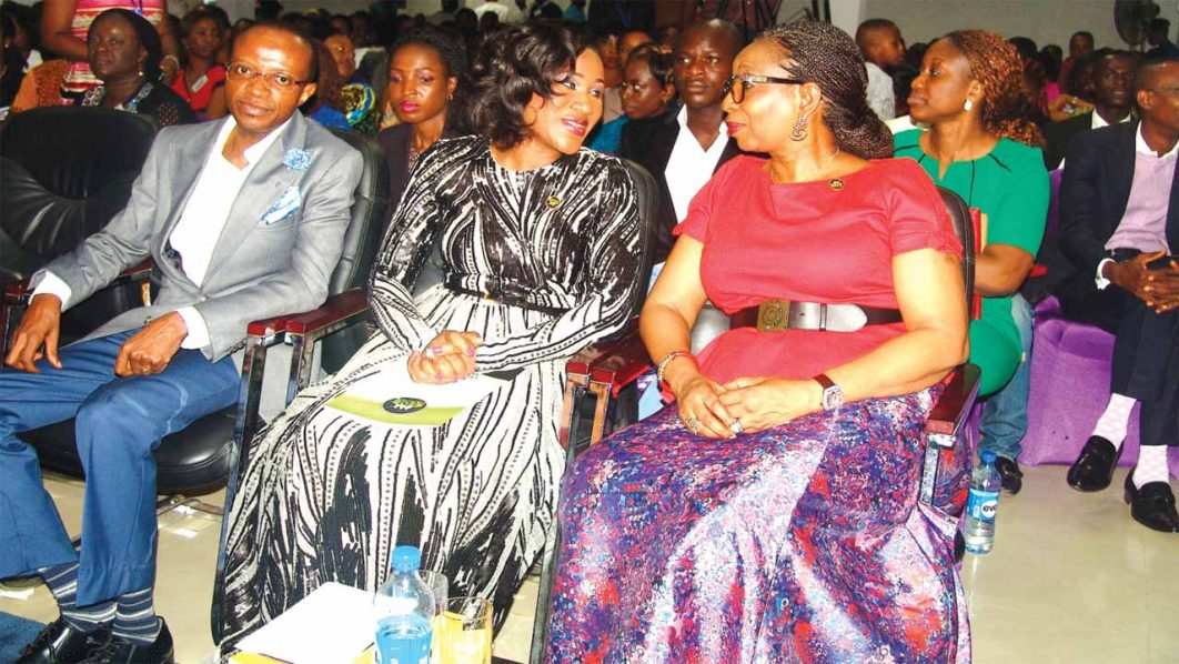 Mrs. Ibukun Awosika (right), Adesunmbo and David Adeoye at the conference