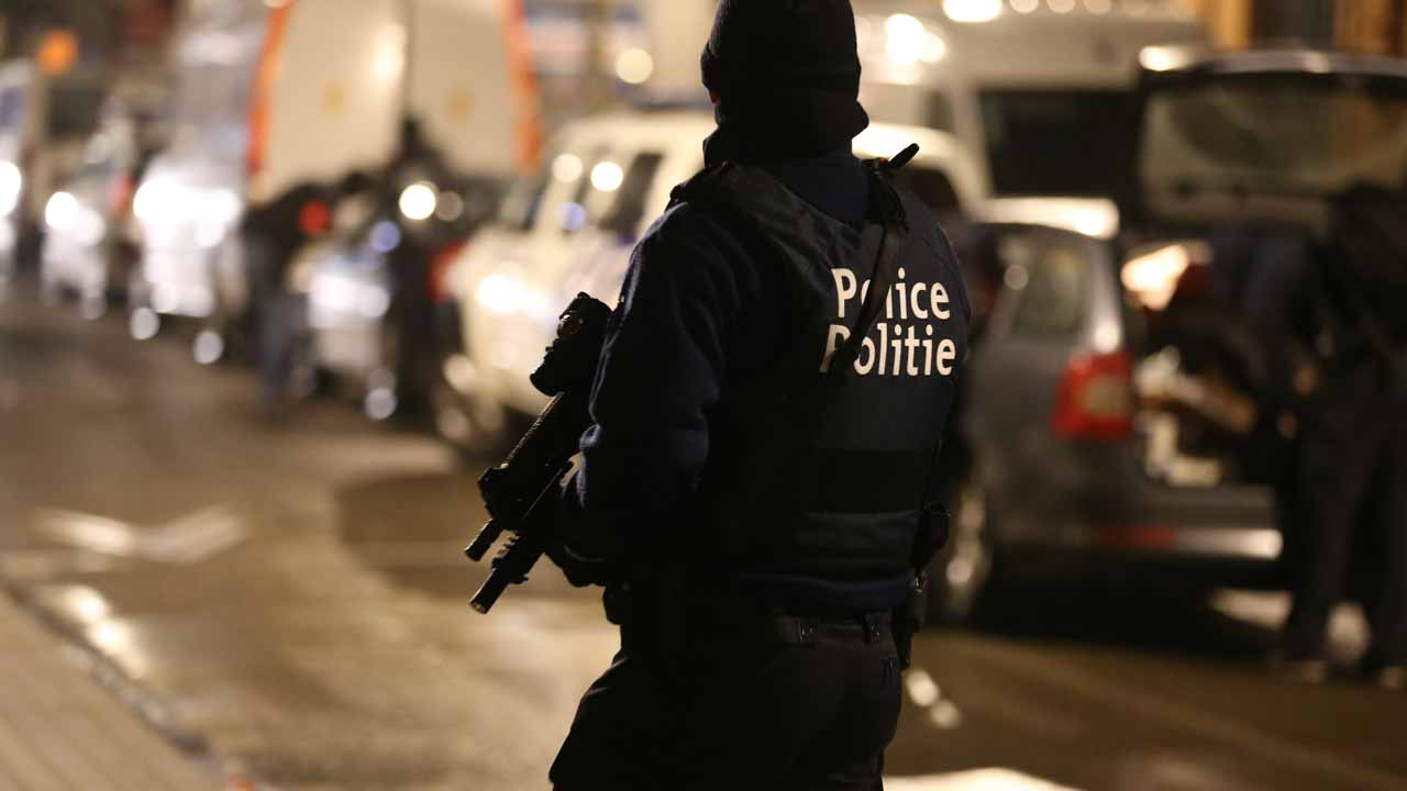 Police officers take part in an operation in Schaerbeek - Schaarbeek, Brussels, late on March 24, 2016. Six people were arrested on March 24, 2016 in a series of police operations in the Belgian capital, the federal prosecutor's office said, two days after jihadist attacks in Brussels left 31 dead. Raids have also taken place in the Brussels district of Schaerbeek where the three airport attackers left from on March 22 morning carrying three explosive-packed suitcases. There have been no arrests in the neighbourhood. NICOLAS MAETERLINCK / Belga / AFP