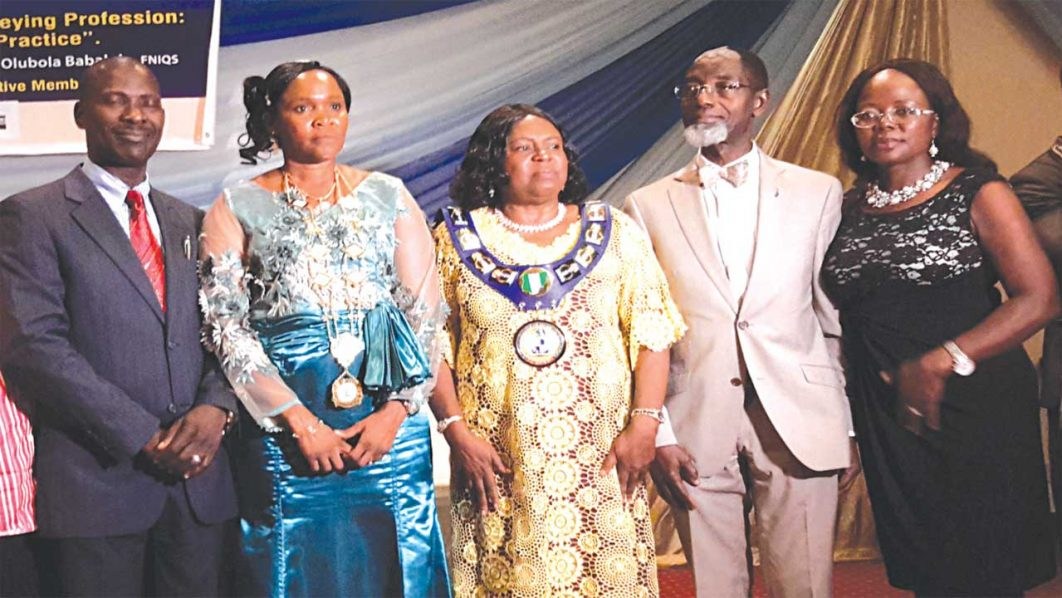 Mr. Oladosu Babalola (left), his wife, Prof. (Mrs) Olubola, the in-coming fourth national chairperson, Women Association of Quantity Surveyors of Nigeria (WAQSN); President, Nigerian Institute of Quantity Surveyors (NIQS), Mrs. Mercy Iyortyer; immediate past president NIQS, Mr. John Agele Alufohai and his wife, Dr. Edith. PHOTO: HAPPINESS OTOKHINE