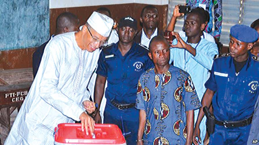 Presidential candidate, Benin Republic's prime minister, Lionel Zinsou (left), casting his ballot during the election in