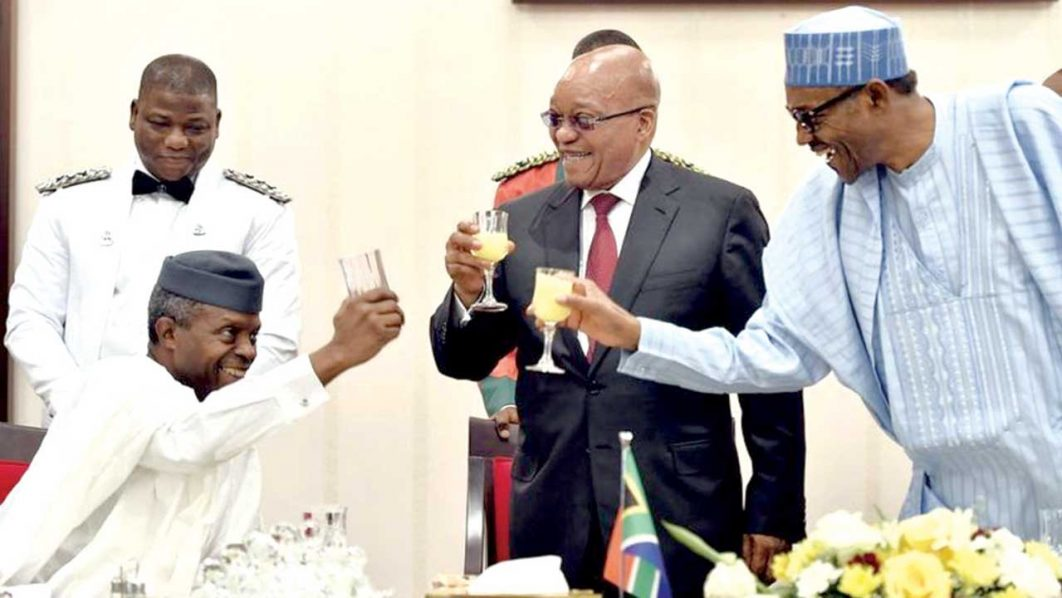 South Africa's President Jacob Zuma toasts with President Muhammadu Buhari and Vice-President Yemi Osinbajo (seated) at a banquet at the end of the South African delegation's visit on March 8, 2016.