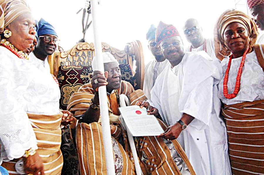 Olubadan of Ibadanland, Oba Saliu Adetunji receiving his Staff of Office from Oyo State Governor, Abiola Ajimobi during his Coronation as 41st Olubadan of Ibadanland at Mapo hill, Ibadan... yesterday PHOTO: NAJEEM RAHEEM