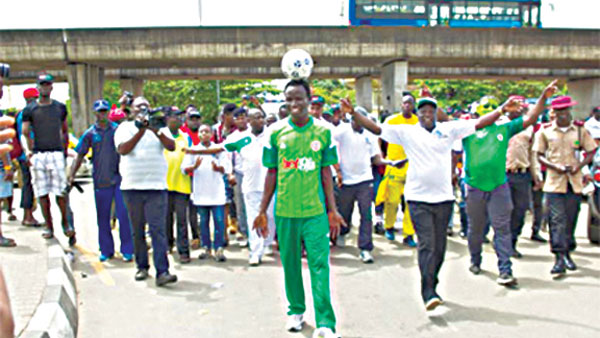 Record breaker…Harrison Chinedu on arrival at the National Stadium with the ball on his head