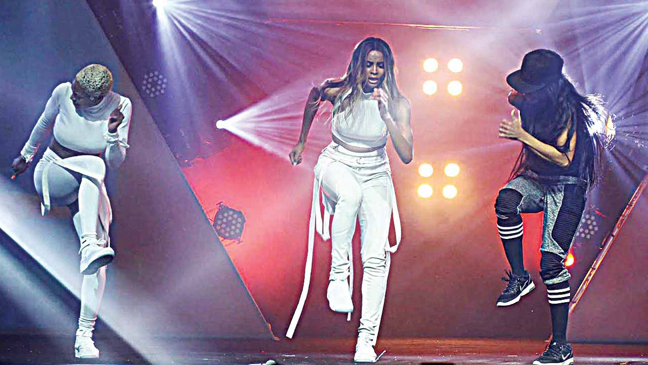 Nigeria's dance queen Kaffy (right) taking America's Ciara (middle) and her dancer through some popular                               Naija dance steps at the Love Live A Movie 3.