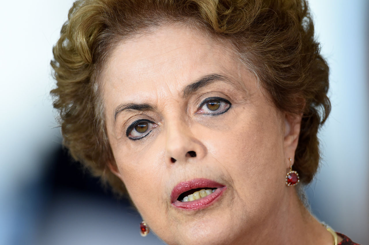 Brazilian President Dilma Rousseff speaks during a press conference at Planalto Palace in Brasilia on March 16, 2016.  Rousseff named her predecessor Luiz Inacio Lula da Silva as her chief of staff Wednesday, sparing him possible arrest for corruption as she seeks to fend off a damaging crisis. AFP PHOTO/EVARISTO SA / AFP / EVARISTO SA