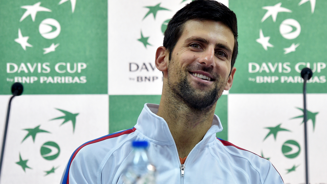 Serbia's ATP number 1 tennis player Novak Djokovic gestures during a press conference ahead of the Davis Cup World Group first round match between Serbia and Kazakhstan in Belgrade, on March 2, 2016. / AFP / ANDREJ ISAKOVIC
