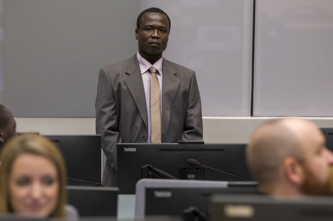 (FILES) This file photo taken on January 21, 2016 shows Ugandan commander of the notorious Lord's Resistance Army (LRA) Dominic Ongwen, sitting in the courtroom of the International Criminal Court (ICC) during the confirmation of charges hearing in the Hague on January 21, 2016. War crimes judges confirmed on March 23, 2016, 70 charges against notorious Lord's Resistance Army commander Dominic Ongwen for crimes committed in Uganda, including keeping sex slaves and recruiting child soldiers. / AFP / ANP / Michael KOOREN
