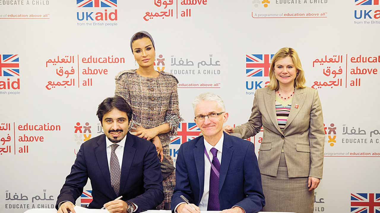 Founder and Chairperson of Education Above All (EAA), Her Highness Sheikha Moza Bint Nasser (left, standing); Secretary of State for International Development and Member of Parliament (MP) Justine Greening (left, sitting) and others during the signing of a five-year partnership agreement between EAA's Educate A Child programme (EAC) and the United Kingdom Department for International Development (DFID), in London... recently