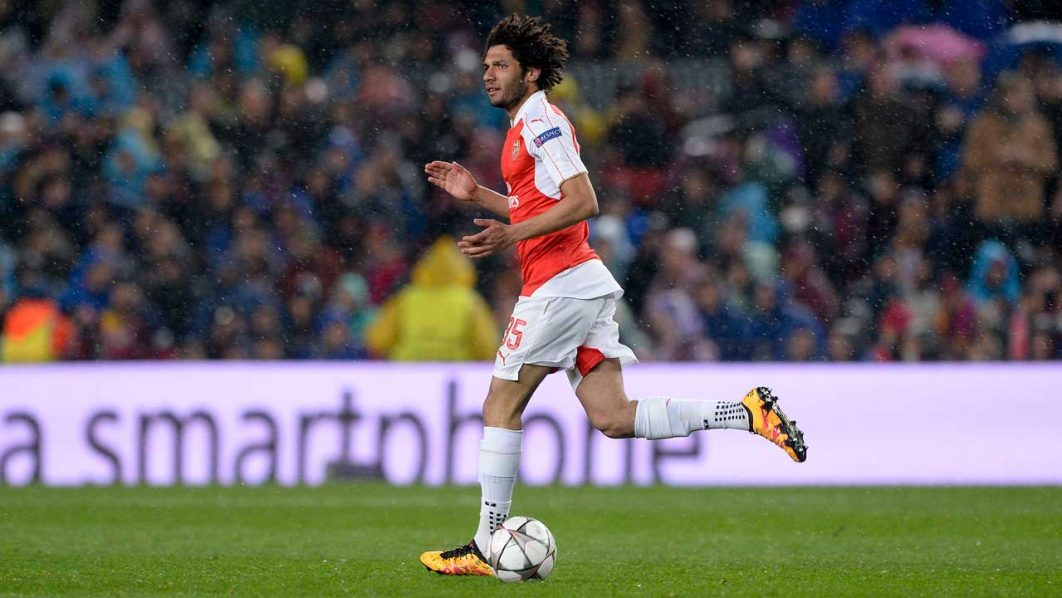 Mohammed Elneny wheels away in delight after scoring against Barcelona… on Wednesday. PHOTO: AFP