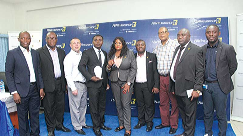 Head, Retail Distribution, FBNInsurance Limited, Umekwe Odinakachi (left); Chief Finance Officer, Festus Izevbizua; Chief Operating Officer, Johan Schalkwyk; winner, Sales Manager Category, Felix Iyobosa Enehizena; overall winner, Financial Advisors' Category, Roseline Iyogwoya Pius; Sales Manager, Mordi Chinedu Valentine; Managing Director/CEO, Val Ojumah; winner, Senior Sales Manager Category, James Ikponmwosa Edokpolor and Chief Human Resources Officer, Emeka Dibia, during the retail yearly competition of the company held in Lagos