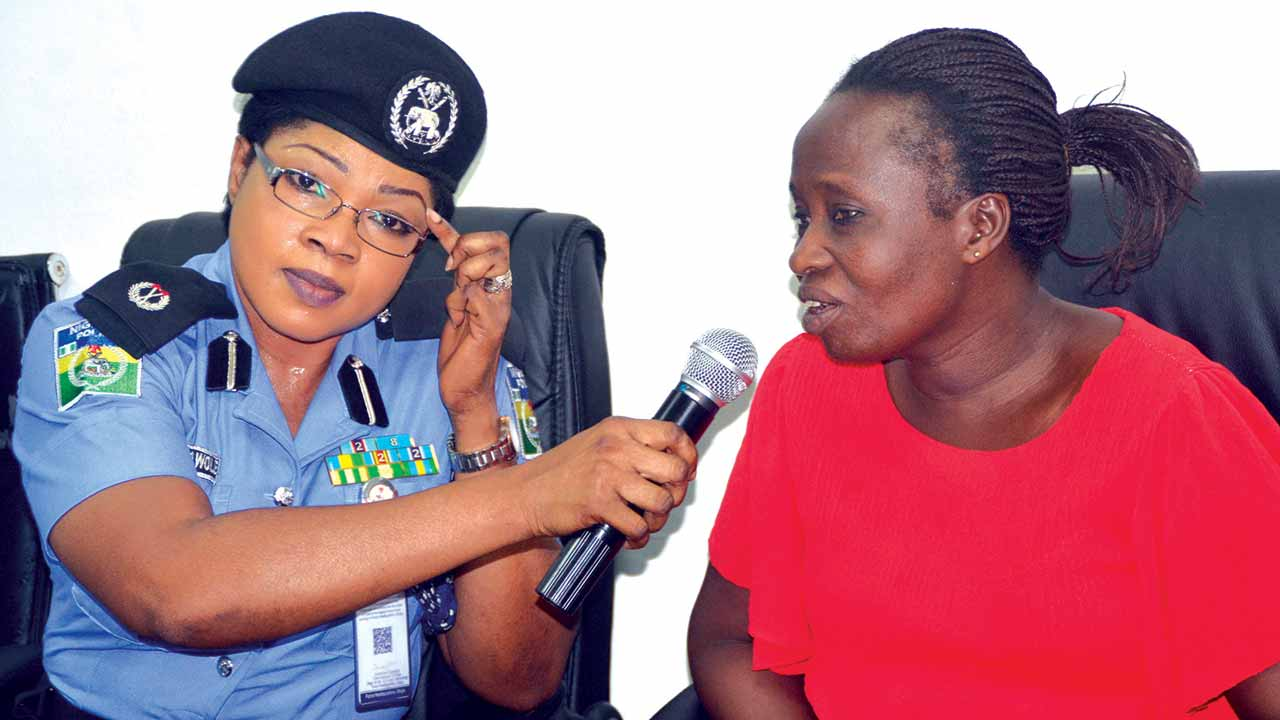 Kidnapped girl Ese Oruru's mother Rose Oruru (right) wth police spokeswoman Bisi Kolawole at the police headquarters in Abuja ...yesterday