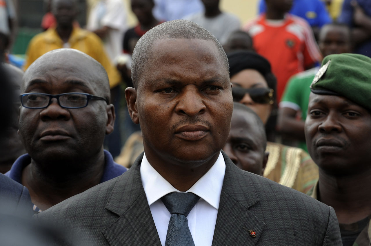 (FILES) This file photo taken on January 5, 2013 shows Central African Republic's Prime Minister Faustin Archange Touadera taking part in a march for peace in Bangui.   The Central African Republic's new president is set to take office on March 30, 2016 faced with the challenge of reconciling a divided population and rebuilding a shattered country. Former maths teacher Faustin-Archange Touadera, 58, was the surprise winner of February elections in the country that had been wracked by three years of communal violence. / AFP / SIA KAMBOU