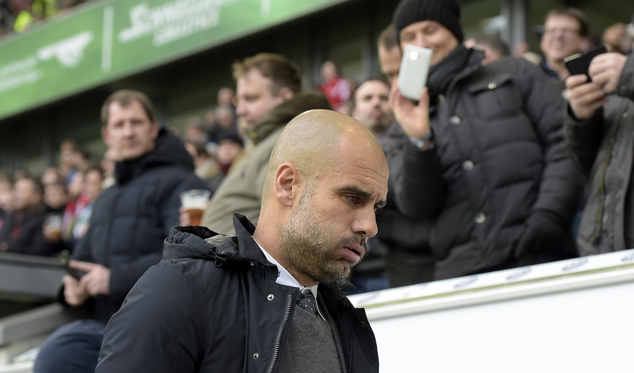 Bayern Munich's Spanish head coach Pep Guardiola arrives for the German first division Bundesliga football match VfL Wolfsburg vs FC Bayern Munich in Wolfsburg, northern Germany, on February 27, 2016. / AFP / TOBIAS SCHWARZ / RESTRICTIONS: DURING MATCH TIME: DFL RULES TO LIMIT THE ONLINE USAGE TO 15 PICTURES PER MATCH AND FORBID IMAGE SEQUENCES TO SIMULATE VIDEO. == RESTRICTED TO EDITORIAL USE == FOR FURTHER QUERIES PLEASE CONTACT DFL DIRECTLY AT + 49 69 650050