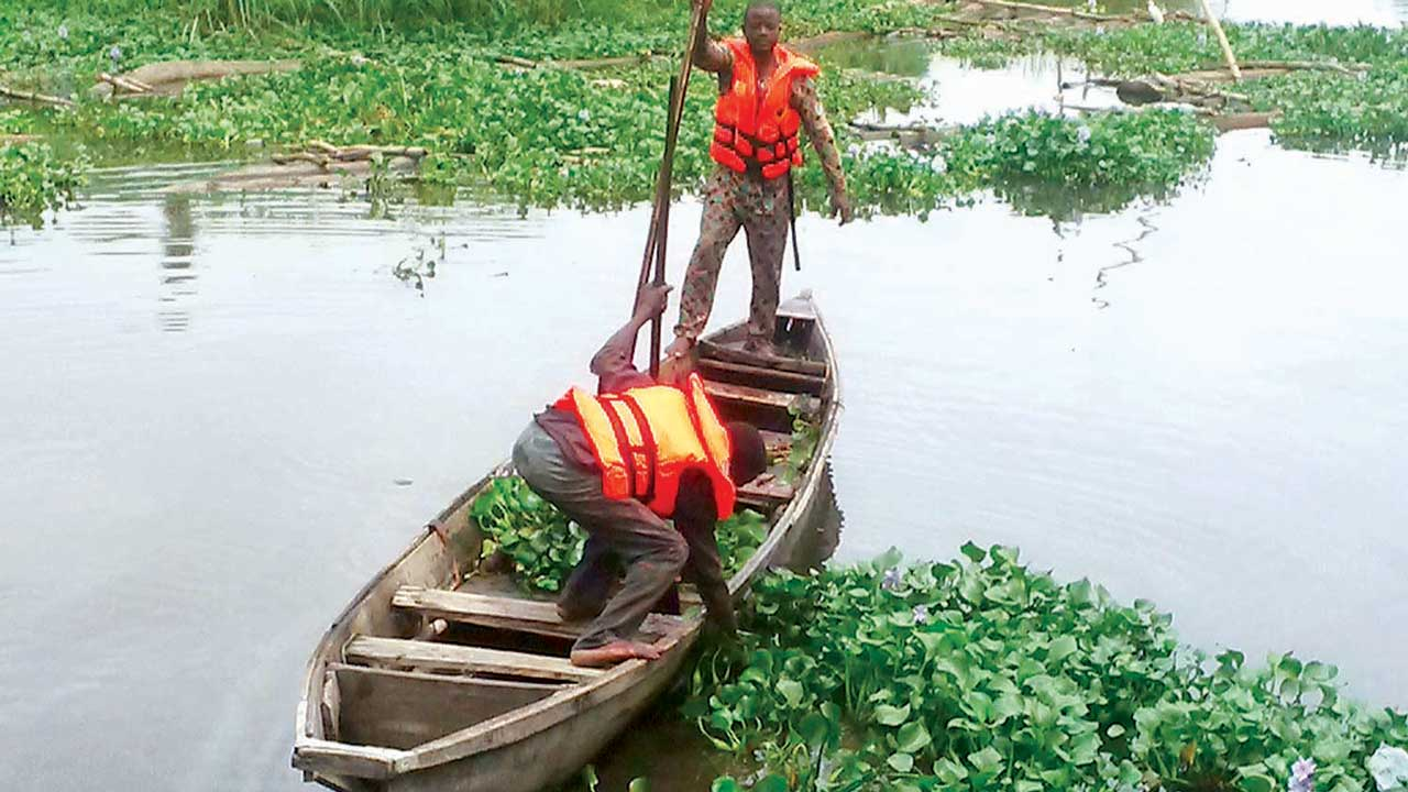 A boatman padding on the Lagos lagoon