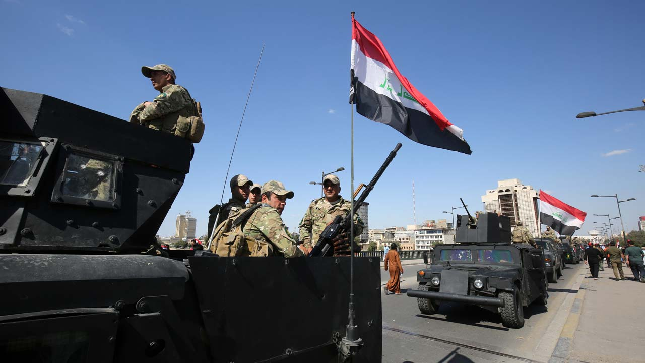 Iraqi security forces stand guard at the main gates of Baghdad's Green Zone during a demonstration by supporters of Iraqi Shiite cleric Moqtada al-Sadr calling for governmental reform and elimination of corruption on March 18, 2016. Thousands of supporters of Iraqi cleric Moqtada Sadr defied a government ban to launch sit-ins at the main gates of Baghdad's Green Zone aimed at pushing for reforms. PHOTO: AFP