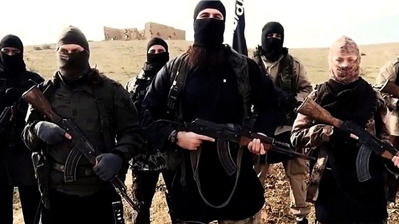 "Mandatory Credit: Photo by REX USA (2642870a) Hayat Boumeddiene, far right Hayat Boumeddiene 'appears in Islamic State film' - 06 Feb 2015 The latest video released by French-speaking Islamic state (ISIS), fighters may be Hayat Boumeddiene, who is believed to have knowledge about the deadly January 9, 2015 attack on a Paris kosher grocery,The video, titled ""Blow Up France 2,"" was released Tuesday and shows an ISIS fighter praising previous attackers in France and calling for new attacks. The video shows a woman standing next to the speaker, wearing camouflage clothing and holding a weapon. French authorities are investigating the possibility this woman could be Hayat Boumeddiene. Her husband, Amedy Coulibaly, killed four hostages January 9 at a kosher grocery in Paris, authorities said. He was killed by police in a rescue and the remaining hostages fled to safety."