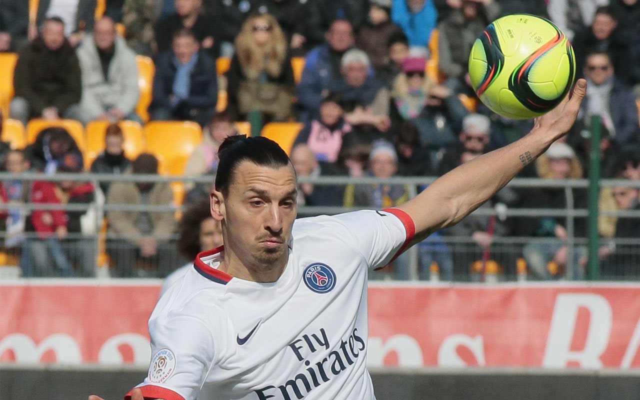 Paris Saint-Germain's Swedish forward Zlatan Ibrahimovic kicks the ball during the French Ligue 1 football match between Troyes and Paris Saint-Germain on March 13, 2016 at the Aube Stadium in Troyes. Paris Saint-Germain clinched a fourth consecutive Ligue 1 title in record time on March 13 after defeating Troyes, obliterating a new French record for the quickest league victory with eight games to spare before the end of the L1 championships. / AFP / JACQUES DEMARTHON