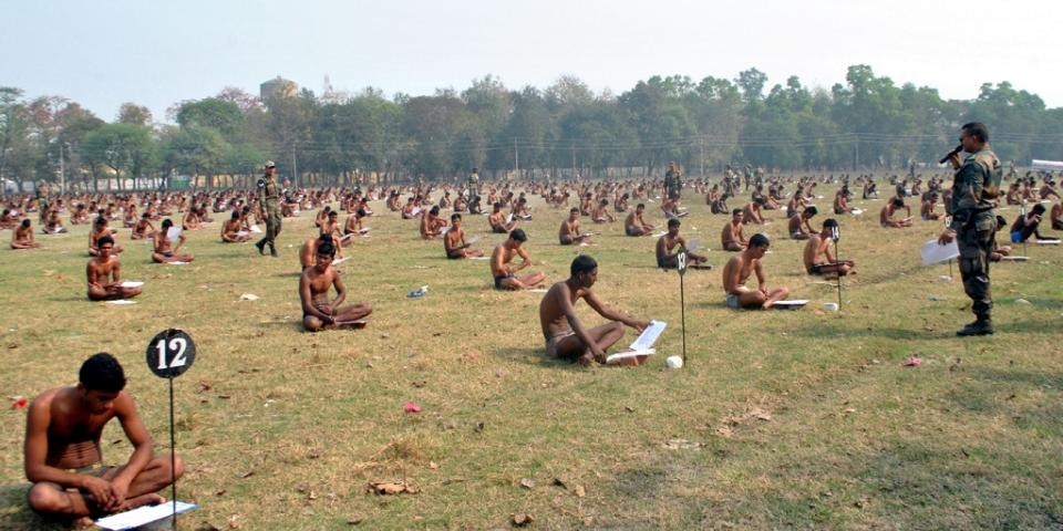 Indian army candidates sit in their underwear in a field as they take a written exam in Muzaffarpur on February 28 2016