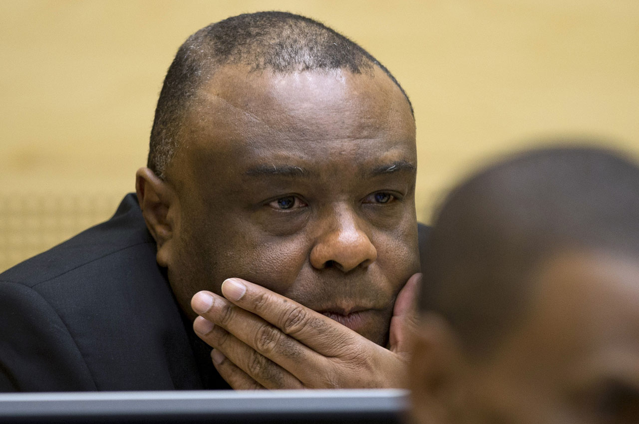 (FILES) This file photo taken on September 29, 2015 shows former vice-president in the transitional government of the Democratic Republic of the Congo Jean-Pierre Bemba Gombo looking on in a court room of the International Criminal Court (ICC) to stand trial on charges including corruptly influencing witnesses by giving them money and instructions to provide false testimony, and presenting false evidence, at The Hague, the Netherlands. War crimes judges deliver their verdict on March 21, 2016 against former Congolese vice president Jean-Pierre Bemba, blamed for unbridled rapes and killings by his private army in neighbouring Central African Republic over a decade ago. / AFP / POOL / PETER DEJONG
