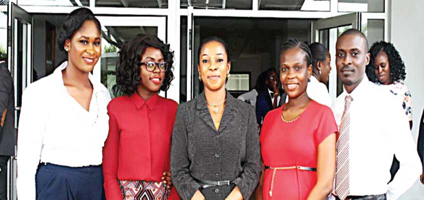 Academic Director for the Owner-Manager Programme at the Lagos Business School (LBS), Dr. Henrietta Onwuegbuzie (middle); and Masters of Business Administration (MBA) students during an investors' forum at the school.