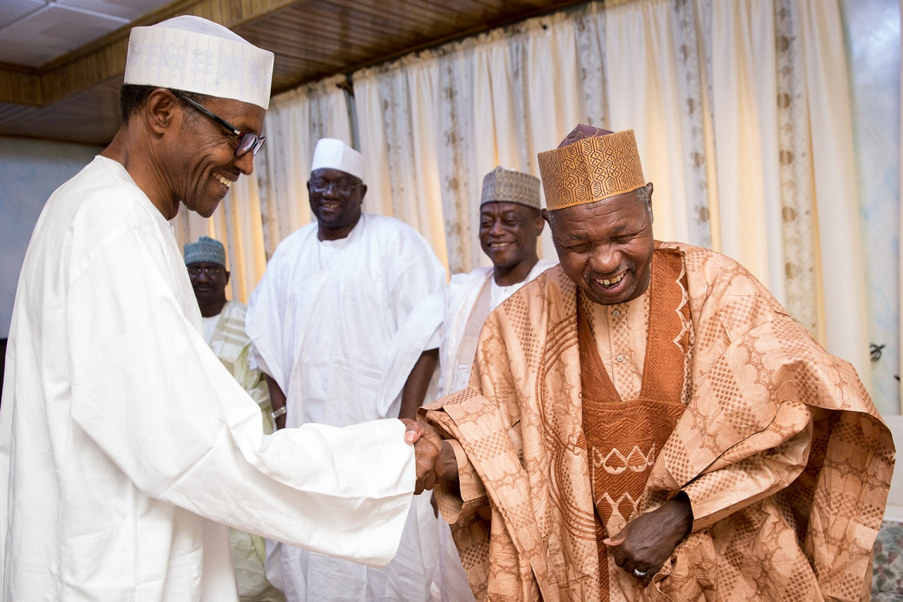 PIX 2. President Elect General Muhammadu Buhari congratulate Katsina state Governor elect Rt hon Aminu Masari when Masari paid hin a courtesy visit in Daura Katsina. PHOTO; SUNDAY AGHAEZE. APR 14 2015