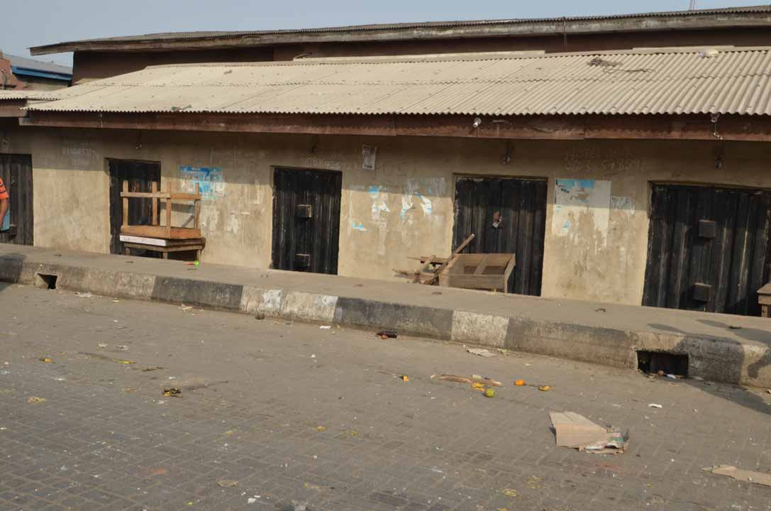 Shops locked up at Mile 12 after a violent clashes which according to the police left 10 people dead and several houses and cars razed.