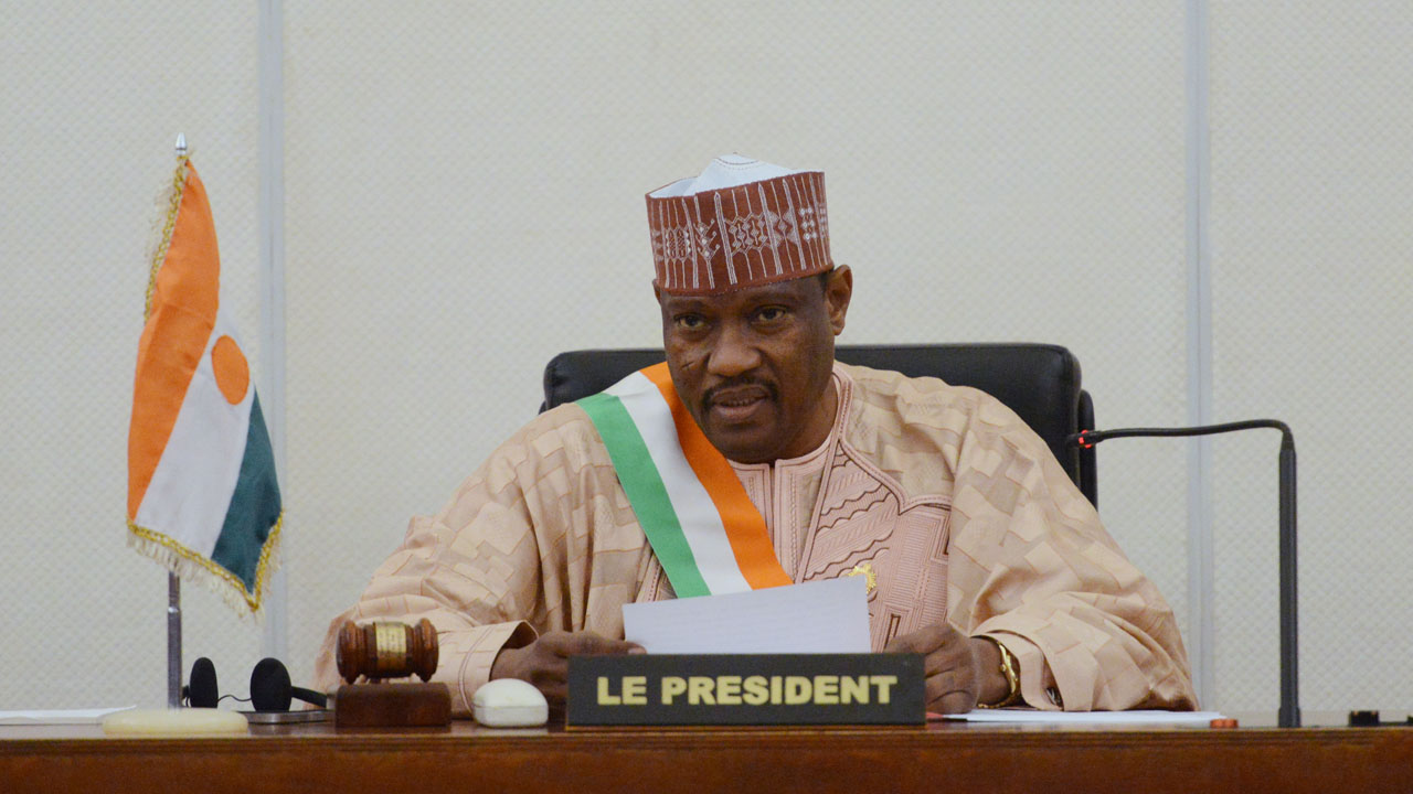"""(FILES) This file photo taken on November 6, 2013 shows Hama Amadou (C), then head of Nigers' parliament, delivering a speech at the Parliament House in Niamey, Niger.  Jailed Niger opposition leader Hama Amadou, who is due to face off against President Mahamadou Issoufou in a March 20 election, was transferred to a hospital on March 11, 2016, an opposition spokesman told AFP. Amadou has eyes problems and """"was evacuated to the Niamey hospital this morning for treatment,"""" said Ousseini Salatou, spokesman for the opposition coalition known as COPA 2016 that backs Amadou for president against the incumbent head of state.  / AFP / ISSOUF SANOGO"""