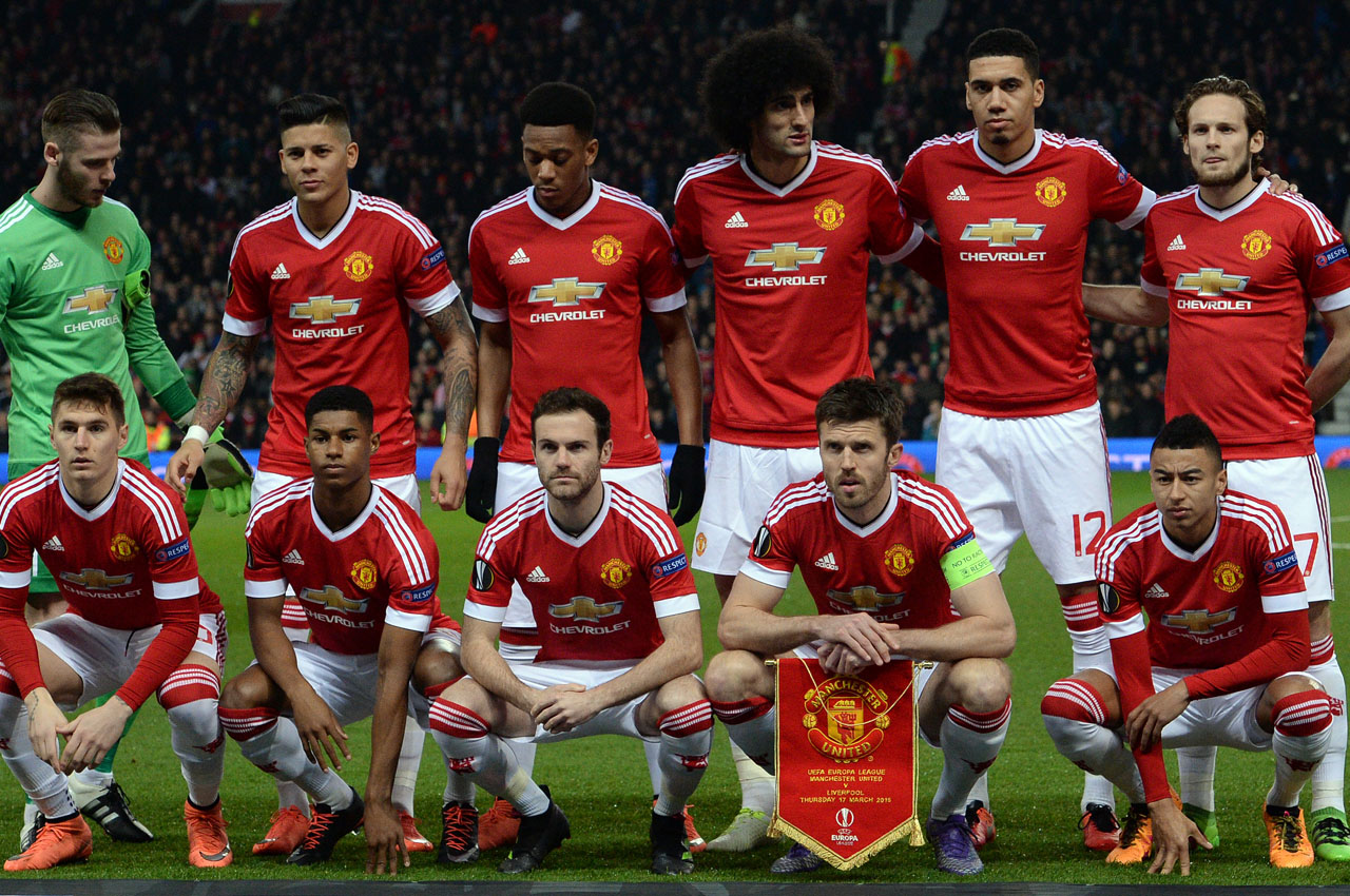Manchester United team (L-R back row) Manchester United's Spanish goalkeeper David de Gea, Manchester United's Argentinian defender Marcos Rojo, Manchester United's French striker Anthony Martial, Manchester United's Belgian midfielder Marouane Fellaini, Manchester United's English defender Chris Smalling and Manchester United's Dutch midfielder Daley Blind (L-R front row) Manchester United's Uruguayan defender Guillermo Varela, Manchester United's English striker Marcus Rashford, Manchester United's Spanish midfielder Juan Mata, Manchester United's English midfielder Michael Carrick and Manchester United's English midfielder Jesse Lingard line-up ahead of the UEFA Europa League round of 16, second leg football match between Manchester United and Liverpool at Old Trafford in Manchester, north west England on March 17, 2016. The game ended 1-1, Liverpool going through 3-1 on aggregate. / AFP / OLI SCARFF