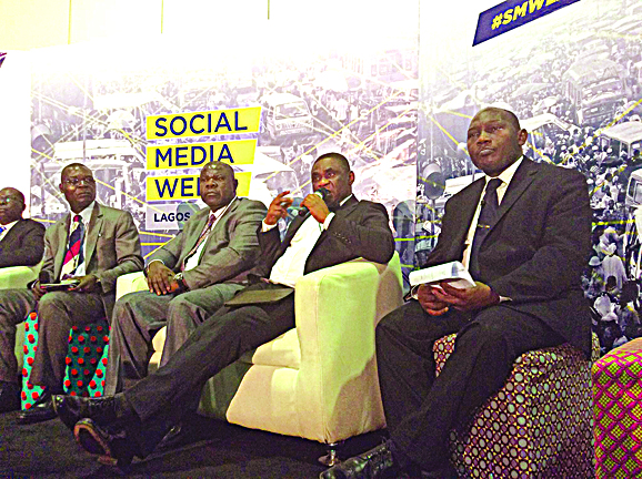 Head, Special publications, Okoh Aihe (left); Director, Corporate Planning & Strategy, Nnamdi Nwokike; Director,Public Affairs, Tony Ojobo (Representing the Executive Vice Chairman, Prof. Umar Danbatta) and the New Media and Information Security executive, Adetunji Bashorun, all of  NCC at the Social Media Week in Lagos.