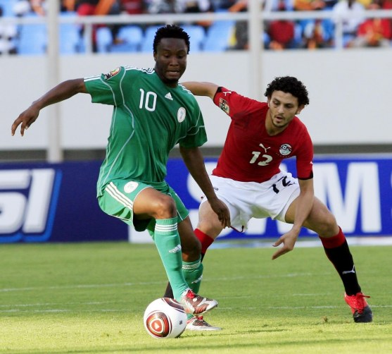 Super Eagles' John Obi Mikel (left) tries to fend off Egypt's Hossam Ghaly when during the Angola 2010 African Nations Cup. Nigeria will meet the Pharaohs in Kaduna…on March 25. PHOTO: AFP.
