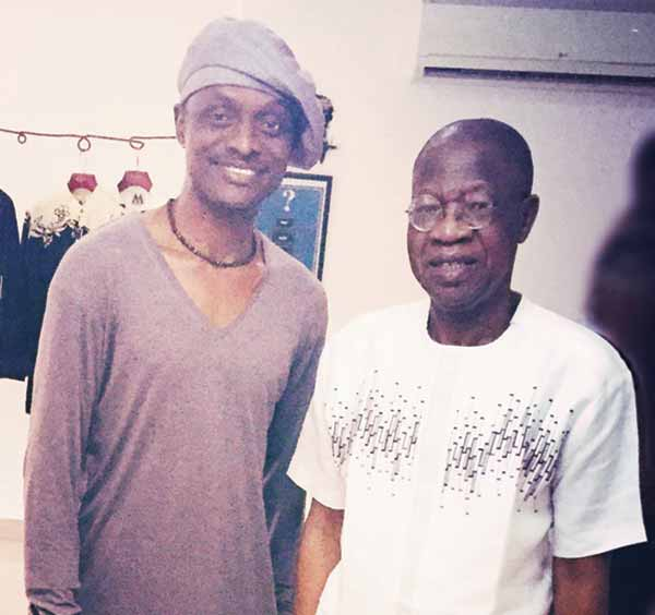 Mudi with Alhaji Lai Mohammed when the minister paid a visit on the designer at his studio in Anthony Village, Lagos.