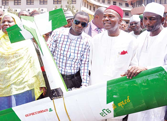 Director General of the National Space Research and Development Agency (NASRDA) Abuja, Dr. Seidu Oneilo Mohammed (right); Minister of Science and Technology, Dr. Ogbonnaya Onu; and the prototype auto piloted airplane inventor, Aghogho Ajiyen, at the Federal Secretariat Abuja where the investor demonstrated the technology to the Minister and workers PHOTO: EMEKA ANUFORO